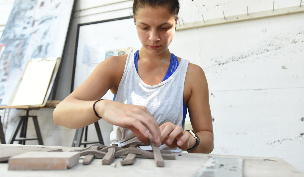 Student working in ceramics studio