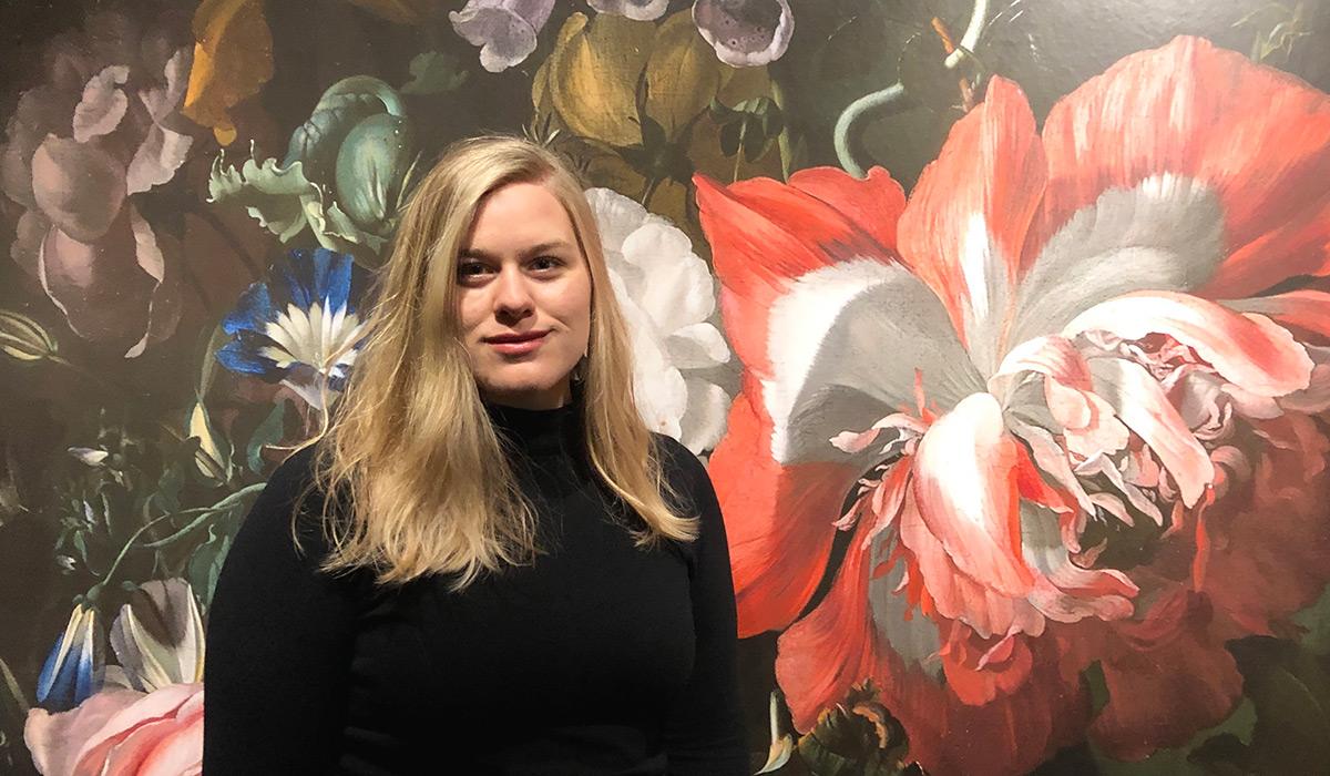 Elizabeth Denholm with artwork behind her